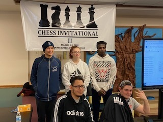 MSD team in front of Chess Invitational sign