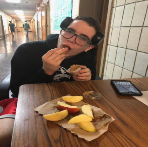 Jake, student, is eating apples and peanut butter