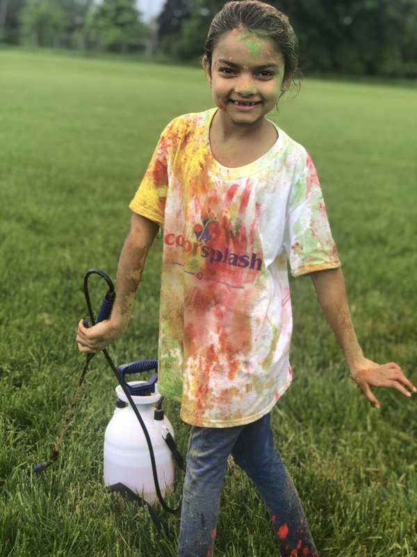 Elementary student posing with color sprayer